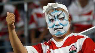 A Japanese supporter gestures as he waits for the start of the Rugby World Cup Pool A game at City of Toyota Stadium between Japan and Samoa in Tokyo City on Saturday. Photo: AP Photo/Shuji Kajiyama
