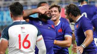 France's Jefferson Poirot, centre, celebrates after scoring a try during their Rugby World Cup Pool C game against the United States at Fukuoka Hakatanomori Stadium. Photo: Christophe Ena/AP