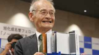 Winner of Nobel Prize in Chemistry Akira Yoshino poses a photo with a model of Lithium-ion battery during a press conference in Tokyo, Wednesday, Oct. 9, 2019. Yoshino is one of the three scientists who have won this year's Nobel Prize in Chemistry for their contributions to lithium-ion batteries, which have reshaped energy storage and transformed cars, mobile phones and many other devices in an increasingly portable and electronic world. (AP Photo/Koji Sasahara)