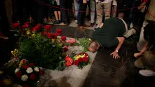 A man kisses the tomb of former Spanish dictator Francisco Franco inside the basilica at the Valley of the Fallen monument near El Escorial, outside Madrid. After a tortuous judicial and public relations battle, Spain's Socialist government has announced that Franco's embalmed body will be relocated from a controversial shrine to a small public cemetery where the former dictator's remains will lie along his deceased wife. File photo: AP Photo/Alfonso Ruiz.