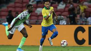 Brazil's Neymar Jr, right, and Nigeria's Anderson Esiti compete for the ball during their international friendly in Singapore on Sunday. Photo: Danial Hakim/AP