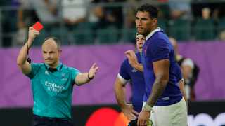 Referee Jaco Peyper shows a red card to France's Sebastien Vahaamahina during the Rugby World Cup quarterfinal match against Wales. Photo: Christophe Ena/AP Photo