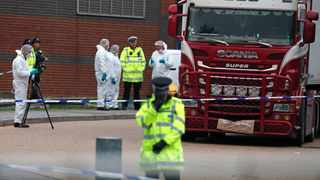 Police forensic officers attend the scene after a truck was found to contain 39 dead bodies in Thurrock, South England, on October 23, 2019.  Photo: AP Photo/Alastair Grant.