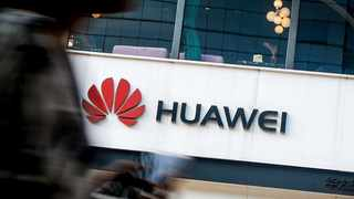 Huawei Technologies said it will hand out 2 billion yuan ($286 million) in cash rewards to staff working to help it weather a US trade blacklisting.  Photo: File