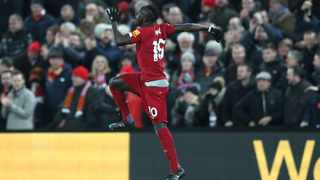 Liverpool's Sadio Mane celebrates after scoring his side's third goal during the English Premier League match against Manchester City at Anfield in Liverpool on Sunday. Photo: Jon Super/AP