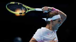 Spain's Rafael Nadal plays a return to Stefanos Tsitsipas of Greece during their ATP World Tours Finals singles tennis match at the O2 Arena in London on Friday. Photo: AP Photo/Alastair Grant