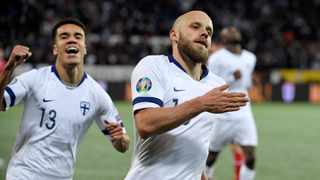 Teemu Pukki of Finland, right, celebrates his goal during their Euro 2020 Group J qualifying soccer match against Liechtenstein in Helsinki on Friday. Photo: Martti Kainuleinen/AP