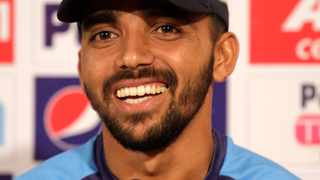 Bangladesh's captain Mominul Haque smiles as he attends a press conference ahead of their second cricket test match against India. Photo: Bikas Das/AP