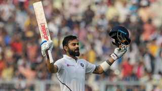 India's Virat Kohli celebrates scoring his hundred during the second day of the second test cricket match against Bangladesh in Kolkata on Saturday. Photo: Bikas Das/AP
