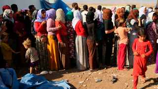 Displaced Iraqis from the Yazidi community gather for humanitarian aid at Nowruz camp, in Derike, Syria. File picture: Khalid Mohammed/AP