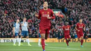 Liverpool's Virgil van Dijk celebrates after scoring his second goal during his team's English Premier League match against Brighton at Anfield Stadium in Liverpool on Saturday. Photo: Jon Super/AP