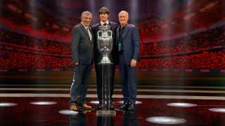 The coaches of Portugal, Fernando Santos, Joachim Low of Germany, and France's Didier Deschamps, who will play in group F, pose with the trophy after the draw for the UEFA Euro 2020 tournament finals in Bucharest. Photo: Vadim Ghirda/AP