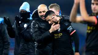 Manchester City manager Pep Guardiola, (left),and Gabriel Jesus embrace after the final whistle during the match at Turf Moor on Tuesday. Photo: Martin Rickett/PA via AP