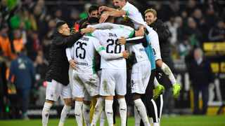 Moenchengladbach's Ramy Bensebaini celebrates with team-mates at the end of their German Bundesliga match against Bayern Munich at the Borussia Park in Moenchengladbach, Germany on Saturday. Photo: Martin Meissner/AP