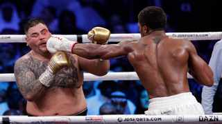 Andy Ruiz Jr., left, takes a jab to the face during his fight against Britain's Anthony Joshua in their World Heavyweight Championship contest at the Diriyah Arena, Riyadh, Saudi Arabia on Sunday. Photo: Hassan Ammar/AP