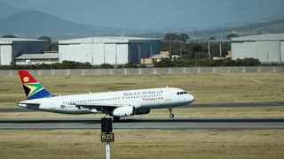 A South African Airways (SAA) aircraft lands at Cape Town International Airport in Cape Town