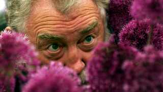 Television botanist David Bellamy takes a close look at an arrangement of Allium Triquetrum at the 2019 Chelsea flower show. Picture: Reuters