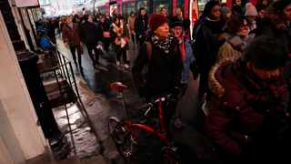Commuters walk to get on a train at the Gare Saint Lazare station in Paris, France. French transport strikes against a planned overhaul of the pension system continue as French President Emmanuel Macron's government remains determined to push ahead with its plans. Picture: Francois Mori/AP