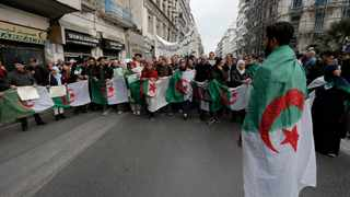 Algerian students take to the streets in the capital Algiers to reject the presidential elections and protest against the government. Picture: Toufik Doudou/AP