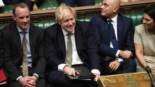 Britain's PM Boris Johnson, center, attends the debate in the House of Commons, London. British lawmakers on Friday approved Johnson's Brexit bill by a wide margin, clearing another hurdle for Britain to leave the EU on January 31. File photo: Jessica Taylor/UK Parliament via AP.