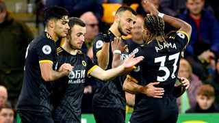 Wolverhampton Wanderers' Romain Saiss, centre, celebrates with team-mates after scoring his side's first goal during their Premier League game against Norwich at Carrow Road in Norwich on Saturday. Photo: Joe Giddens/AP