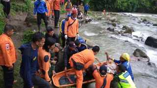 A number of people were killed when the passenger bus plunged into the ravine on Sumatra island after its brakes apparently malfunctioned, police said Tuesday. Picture: BASARNAS via AP
