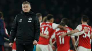 Ole Gunnar Solskjaer has hit back angrily at Robin van Persie after the former Manchester United striker criticised him for smiling after the defeat at Arsenal. Photo: Matt Dunham/AP Photo
