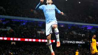 Manchester City's Phil Foden celebrates after scoring his side's fourth goal during their English FA Cup third round soccer match against Port Vale at the Etihad Stadium in Manchester on Saturday. Photo: Martin Rickett/AP