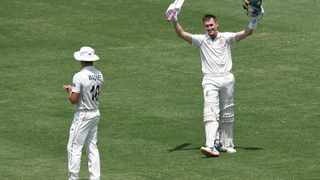 Marnus Labuschagne scored a maiden double century to drive Australia to 454 all out before New Zealand's openers resisted the home attack to post 63 without loss on the second day of the third test on Saturday. Photo: Andrew Cornaga/Photosport via AP