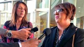 """Michelle Balogh, right, and Kelly Willis speak to reporters Wednesday, Jan. 8, 2020 following the sentencing of the Mexican man who killed their brother, U.S. Border Patrol agent Brian Terry, in December 2010, outside court in Tucson, Ariz.  Heraclio Osorio-Arellanes, convicted of murder in the fatal shooting of Border Patrol agent Brian Terry, in a case that exposed a botched federal gun program known as """"Fast and Furious"""" has been sentenced to life in prison. A federal judge sentenced Osorio-Arellanes in a Tucson courtroom after hearing tearful statements from the sisters of Brian Terry. (Astríd Galván)"""