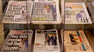 Newspapers are seen for sale in London. Picture: AP Photo/Kirsty Wigglesworth