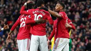 Manchester United's Marcus Rashford celebrates with team-mates after scoring their first goal against Norwich City at Old Trafford on Saturday. Photo: Jon Super/Reuters