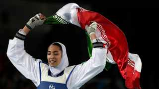 """Kimia Alizadeh Zenoorin celebrates after winning the bronze medal in a women's Taekwondo 57-kg competition at the 2016 Summer Olympics in Rio de Janeiro. Zenoorin, Iran's only female Olympic medalist, said she defected from the Islamic Republic in a blistering online letter that describes herself as """"one of the millions of oppressed women in Iran."""" File picture: Andrew Medichini/AP"""