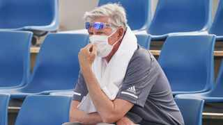A spectator wears a mask as smoke haze shrouds Melbourne during an Australian Open practice session at Melbourne Park in Australia on Tuesday. Photo: Michael Dodge/AAP Image via AP