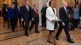 House Sergeant at Arms Paul Irving and Clerk of the House Cheryl Johnson carry the articles of impeachment against President Donald Trump to Secretary of the Senate Julie Adams on Capitol Hill in Washington. Picture: Manuel Balce Ceneta/AP/African News Agency (ANA)
