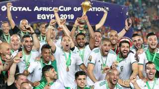 FILE - Algeria's Riyad Mahrez lifts the trophy as they celebrate winning the Africa Cup of Nations in 2019. Photo: Suhaib Salem/Reuters
