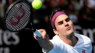 Roger Federer in action against Tennys Sandgren in their quarterfinal match at the Australian Open in Melbourne on Tuesday. Picture: AP Photo/Andy Brownbill