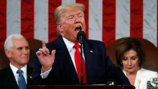 President Donald Trump delivers his State of the Union address to a joint session of Congress in the House Chamber on Capitol Hill in Washington as Vice President Mike Pence and Speaker Nancy Pelosi look on. Picture: Leah Millis/Pool via AP