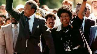 Nelson Mandela and his wife, Winnie Madikizela-Mandela, gesture as Mandela walks free from the Victor Verster Prison in Paarl, Cape Town. File picture: AP Photo/Greg English