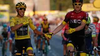 Colombia's Egan Bernal wearing the overall leader's yellow jersey, left, holds hands with Britain's Geraint Thomas after winning the 2019 Tour de France cycling race in Paris. Photo: AP Photo/Michel Euler