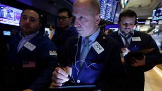 Trader Michael Urkonis, center, works on the floor of the New York Stock Exchange, Tuesday, March 10, 2020. Stocks, Treasury yields and oil are clawing back some of the plunge they took a day before, when the S&P 500 had its worst drop in more than a decade. (AP Photo/Richard Drew)