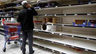 A view shows empty shelves at a Carrefour supermarket as people began stockpiling food in Gennevilliers, near Paris