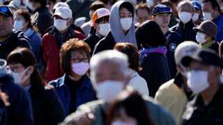 Spectators wait to see the Olympic flame display ceremony in Iwaki, Fukushima Prefecture, northern Japan. Picture: Eugene Hoshiko/AP