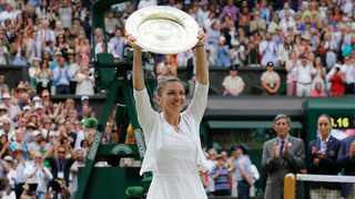 Romania's Simona Halep holds up the trophy after defeating United States' Serena Williams in the women's singles final match at the Wimbledon Tennis Championships 2019 in London.  Wimbledon has been canceled for the first time since World War II because of the coronavirus pandemic. Photo: AP Photo/Kirsty Wigglesworth
