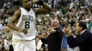 FILE PHOTO: Boston Celtics power forward Antoine Walker listens to the cheers of the home crowd in his side's 110-90 win over Indiana Pacers in game six of their Eastern Conference first round playoff series.
