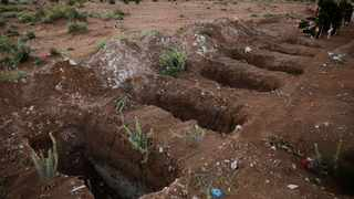 Open graves are seen in a cemetery after the government announcement to close all cemeteries during the weekend of Mother's Day, as the outbreak of the coronavirus disease (COVID-19) continues in Ciudad Juarez