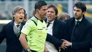 FILE - Inter Milan coach Antonio Conte argues with referee Gianluca Manganiello after he sent off Lautaro Martinez during their Serie A match against Cagliari. Photo: Alessandro Garofalo/Reuters