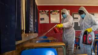 Disinfection team disinfect the classroom at Ivory Park Secondary School in Johannesburg. Picture: Themba Hadebe/AP/African News Agency (ANA)