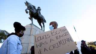 Protesters call for the removal of a statue of Louis Botha, former prime minister of South Africa, outside Parliament in Cape Town. Picture: African News Agency (ANA)