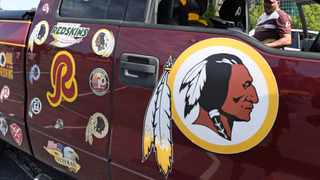 Rodney Johnson of Chesapeake, Va., stands with his truck outside FedEx Field in Landover, Md., Monday, July 13, 2020. Photo: AP Photo/Susan Walsh